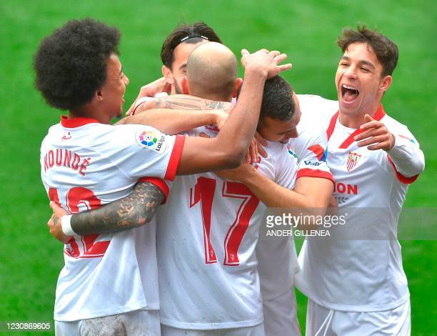 Sevilla's Spanish midfielder Joan Jordan celebrates with teammates after scoring during the Spanish league football match SD Eibar against Sevilla FC...