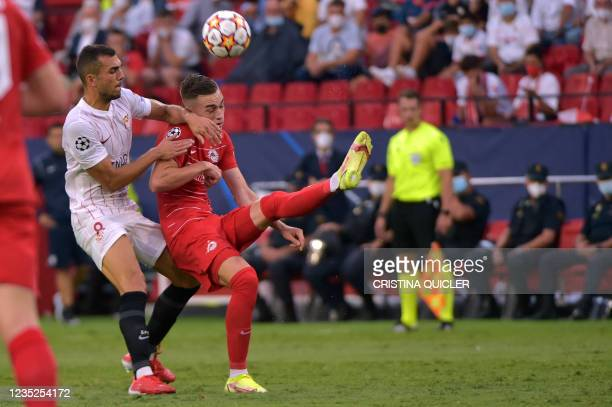Sevilla's Spanish midfielder Joan Jordan vies with Salzburg's Croatian midfielder Luka Susic during the UEFA Champions League first round group G...