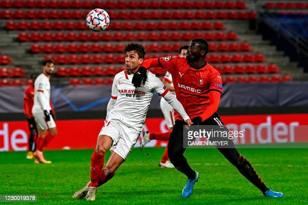 Sevilla's Spanish midfielder Olivier Torres and Rennes' French-Senegalese forward Mbaye Niang fight for the ball during the UEFA Champions League...