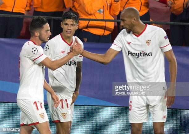 Sevilla's Spanish midfielder Pablo Sarabia celebrates a goal with Sevilla's Argentinian midfielder Joaquin Correa and Sevilla's French midfielder...