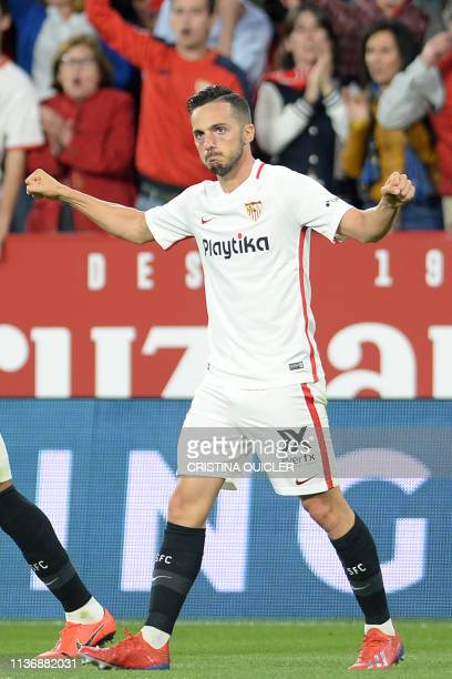Sevilla's Spanish midfielder Pablo Sarabia celebrates after scoring a goal during the Spanish league football match between Sevilla FC and Real Betis...