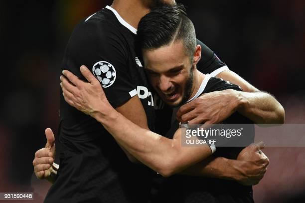 Sevilla's Spanish midfielder Pablo Sarabia celebrates after winning a last 16 second leg UEFA Champions League football match between Manchester...