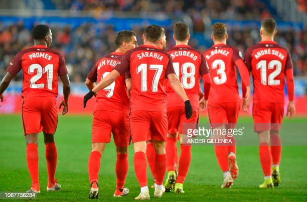 Sevilla's Spanish midfielder Pablo Sarabia celebrates with teammates after scoring during the Spanish league football match Deportivo Alaves against...