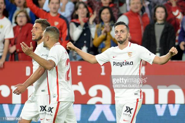 Sevilla's Spanish midfielder Pablo Sarabia celebrates with teammates after scoring a goal during the Spanish league football match between Sevilla FC...