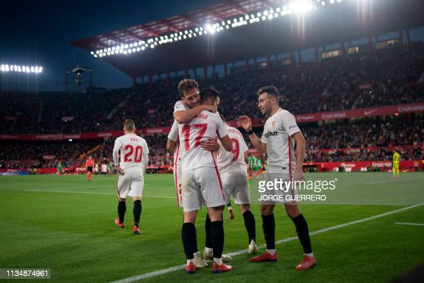 Sevilla's Spanish midfielder Pablo Sarabia is congratulated by teammates for his goal during the Spanish league football match between Sevilla FC and...