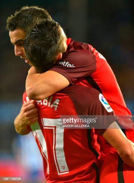 Sevilla's Spanish midfielder Pablo Sarabia is congratulated by teammate French forward Ben Yedder after scoring during the Spanish league football...