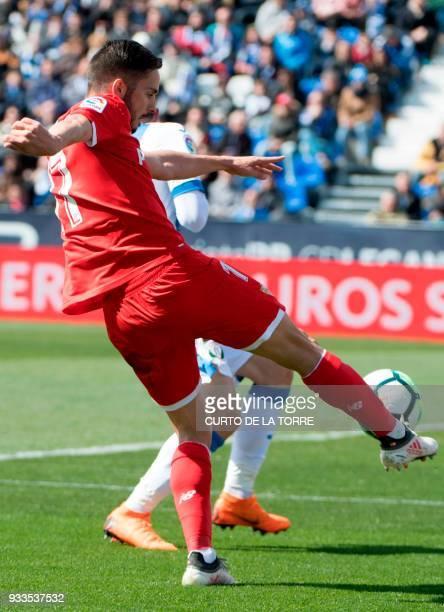 Sevilla's Spanish midfielder Pablo Sarabia kicks the ball during the Spanish League football match between Club Deportivo Leganes SAD and Sevilla FC...