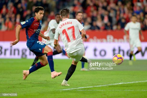 Sevilla's Spanish midfielder Pablo Sarabia shoots to score a goal during the Spanish league football match between Sevilla FC and SD Huesca at the...