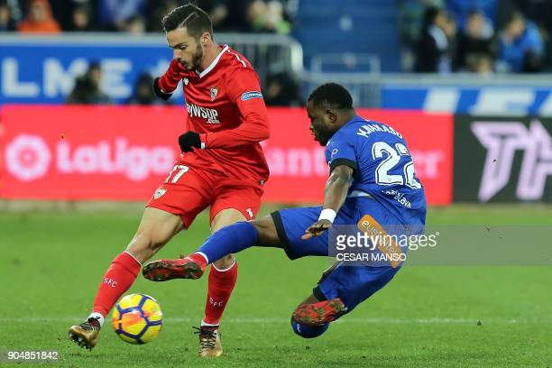 Sevilla's Spanish midfielder Pablo Sarabia vies with Alaves' Ghanaian midfielder Mubarak Wakaso during the Spanish league football match between...