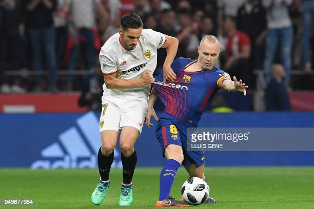 Sevilla's Spanish midfielder Pablo Sarabia vies with Barcelona's Spanish midfielder Andres Iniesta during the Spanish Copa del Rey final football...