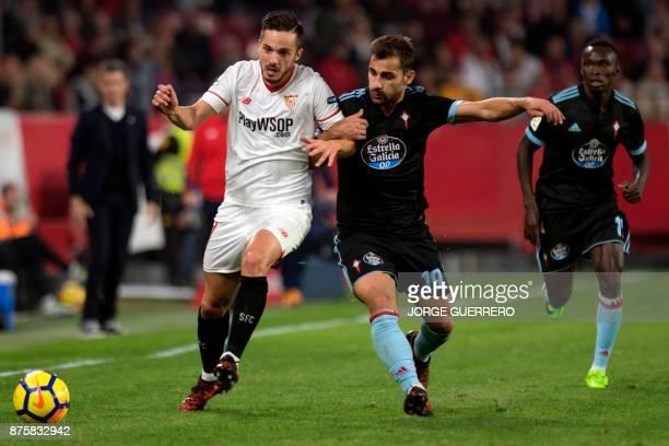 Sevilla's Spanish midfielder Pablo Sarabia vies with Celta Vigo's Spanish defender Jonny Castro during the Spanish league football match Sevilla vs...