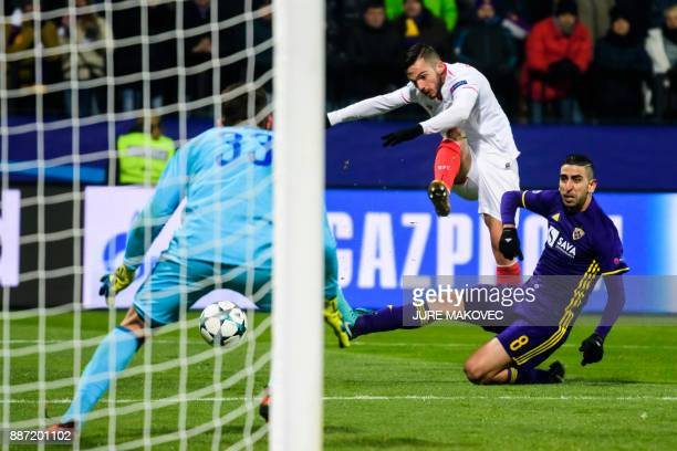 Sevilla's Spanish midfielder Pablo Sarabia vies with Maribor's Israeli midfielder Marwan Kabha during the UEFA Champions League Group E football...