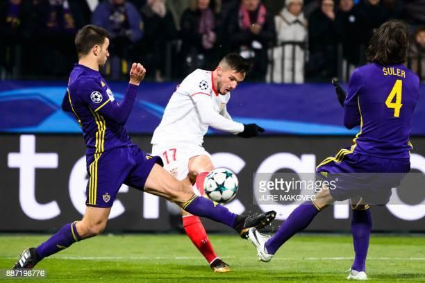 Sevilla's Spanish midfielder Pablo Sarabia vies with Maribor's Slovenian defender Mitja Viler and Slovenian defender Marko Suler during the UEFA...