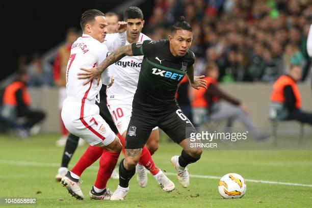 Sevilla's Spanish midfielder Roque Mesa Quevedo Sevilla's Argentine midfielder Ever Banega and FK Krasnodar's Ecuadorian defender Cristian Ramirez...