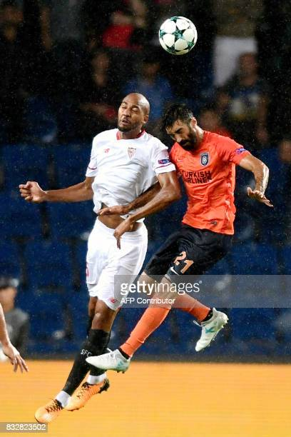 Sevilla's Steven N'Zonzi heads the ball next to Basaksehir's Mahmut Tekdemir during the UEFA Champions League play-off first leg football match...