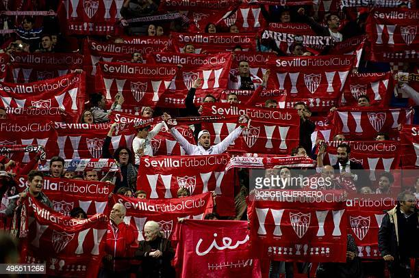 Sevilla's supporters wave club standards before the UEFA Champions League football match Sevilla FC vs Manchester City at the Ramon Sanchez Pizjuan...