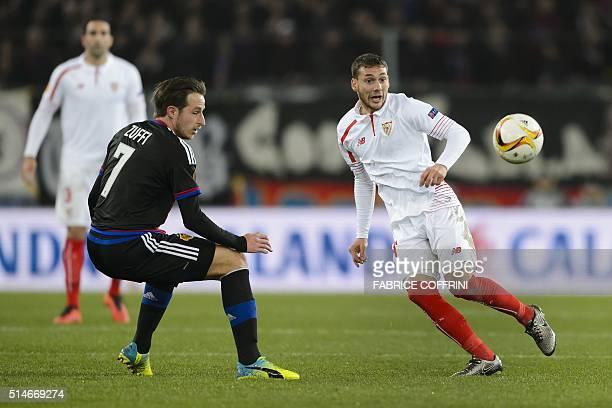 Sevilla's Uruguayan midfielder Sebastian Cristoforo vies with Basel's Swiss midfielder Luca Zuffi during the UEFA Europa League round of 16 first leg...