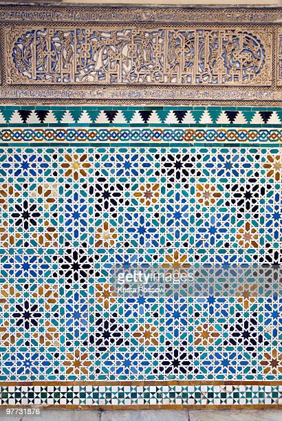 Detail of tiles and plaster carving at Alcazar Royal Palaces, Seville.
