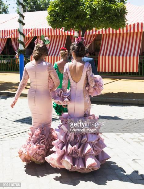 Seville Seville Province Andalusia southern Spain Feria de Abril the April Fair Young women wearing flamenco dresses