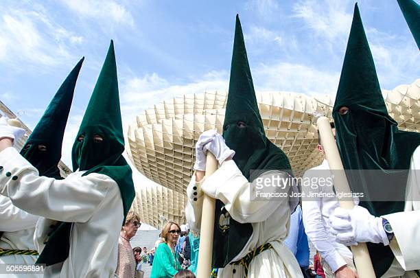 """Seville, Spain, 14 april, 2014. Penitents of the brotherhood of """"El Beso de Judas"""" In their procession by Seville, Passing through the square """"La..."""