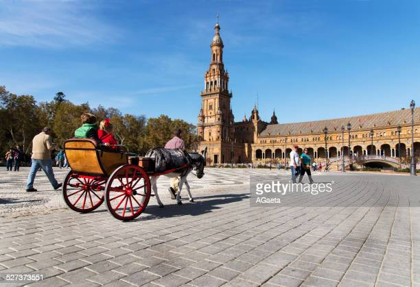 siviglia, spagna, piazza di spagna - animal powered vehicle stock photos and pictures