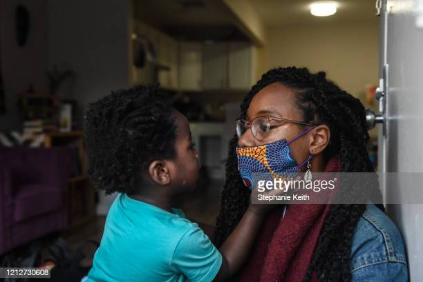 Sevonna Brown of Black Women's Blueprint a mutual aid group looks at her son Panther Herd on May 11 2020 in the BedfordStuyvesant neighborhood in the...