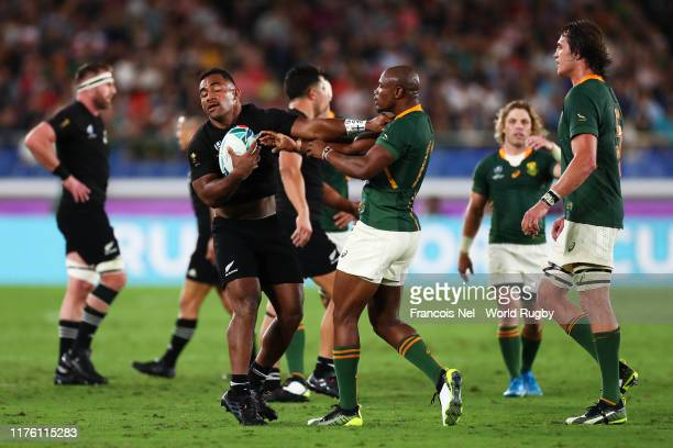 Sevu Reece of New Zealand and Makazole Mapimpi of South Africa argue during the Rugby World Cup 2019 Group B game between New Zealand and South...