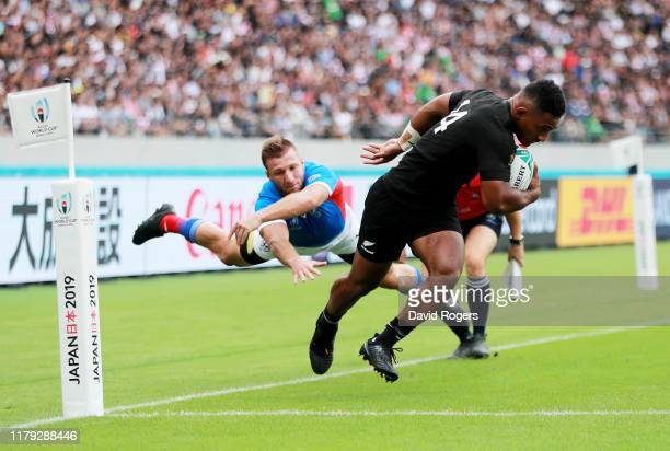 Sevu Reece of New Zealand fends off the tackle of Johan Tromp of Namibia to score his side's first try during the Rugby World Cup 2019 Group B game...