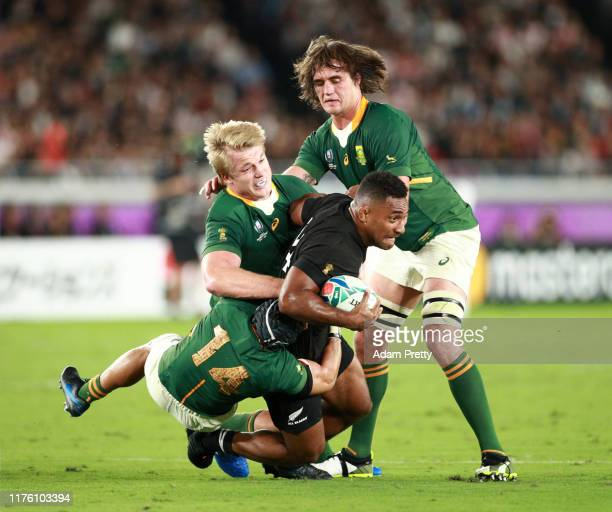 Sevu Reece of New Zealand is tackled during the Rugby World Cup 2019 Group B game between New Zealand and South Africa at International Stadium...