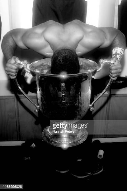 Sevu Reece of the All Blacks celebrates with the Bledisloe Cup after winning the 2019 Rugby Championship Test Match between the New Zealand All...