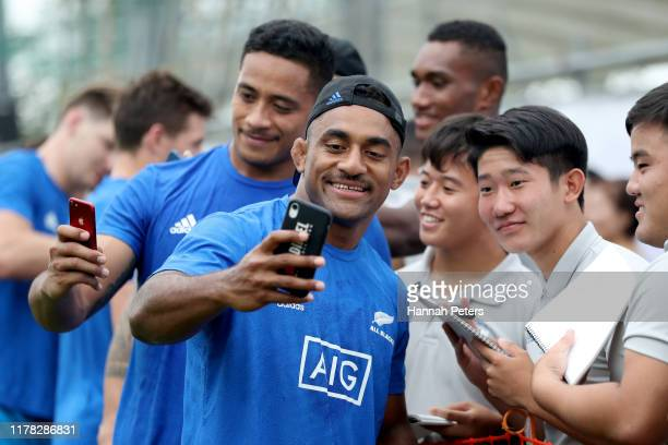 Sevu Reece of the All Blacks poses for pictures with fans following the New Zealand Captain's Run at Jissoji Tamokuteki Ground on October 01 2019 in...