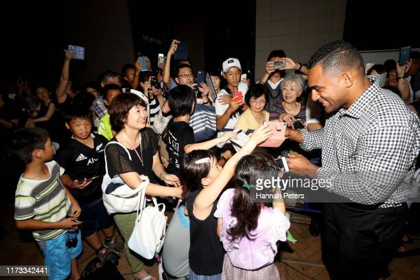 Sevu Reece of the All Blacks signs autographs for fans after arriving to their hotel on September 09 2019 in Kashiwa Chiba Japan