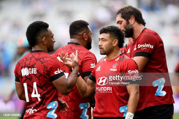 Sevu Reece of the Crusaders celebrates with Richie Mo'unga of the Crusaders after winning the round four Super Rugby Aotearoa match between the Blues...