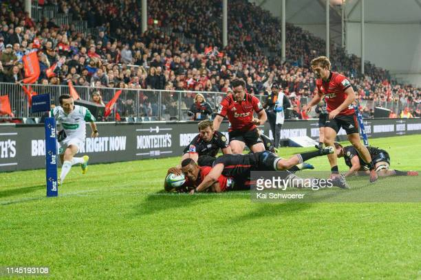 Sevu Reece of the Crusaders dives over to score a try during the round 11 Super Rugby match between the Crusaders and Lions at Christchurch Stadium...