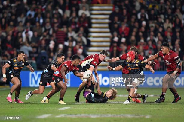 Sevu Reece of the Crusaders grabs the ball from Damian McKenzie of the Chiefs during the Super Rugby Aotearoa Final match between the Crusaders and...