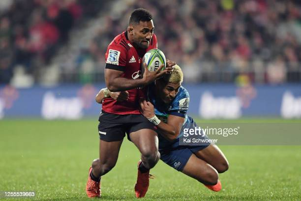 Sevu Reece of the Crusaders is tackled by Rieko Ioane of the Blues during the round 5 Super Rugby Aotearoa match between the Crusaders and the Blues...