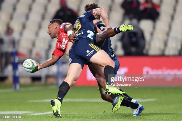 Sevu Reece of the Crusaders offloads the ball during the round 9 Super Rugby match between the Crusaders and Highlanders at Christchurch Stadium on...