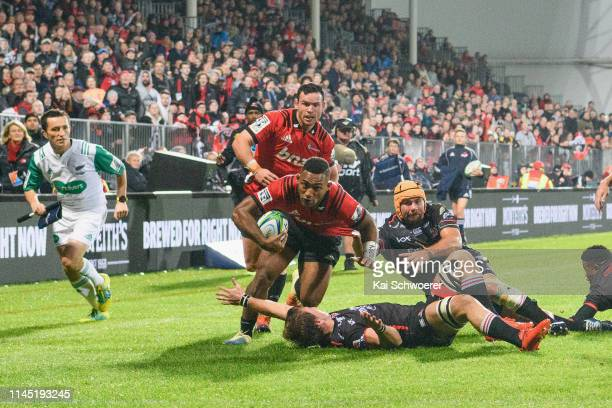 Sevu Reece of the Crusaders runs through to score a try during the round 11 Super Rugby match between the Crusaders and Lions at Christchurch Stadium...