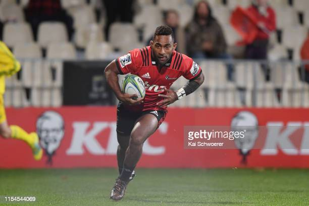 Sevu Reece of the Crusaders runs through to score a try during the round 17 Super Rugby match between the Crusaders and the Rebels at Christchurch...