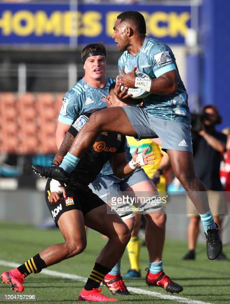 Sevu Reece of the Crusaders takes a high ball defended by Solomon Alaimalo C 0during the round 2 Super Rugby match between the Chiefs and the...