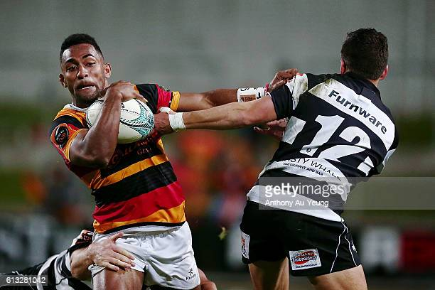 Sevu Reece of Waikato fends against Tiaan Falcon of Hawke's Bay during the round eight Mitre 10 Cup match between Waikato and Hawke's Bay at FMG...