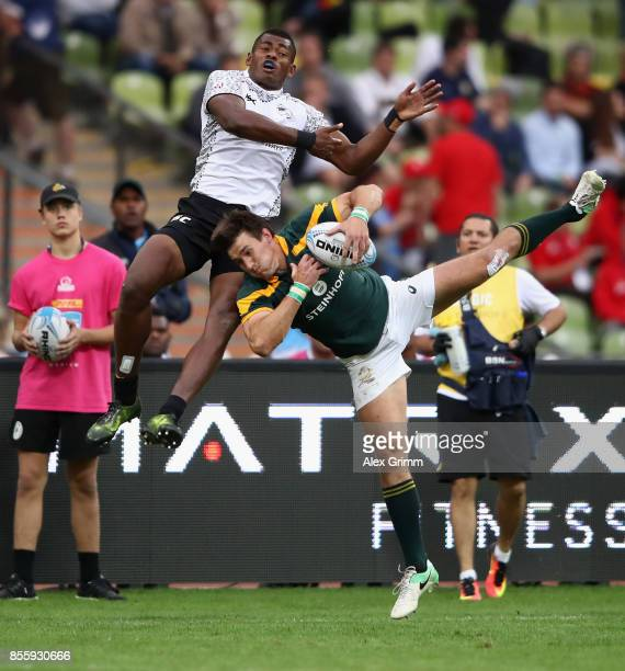 Sevuloni Mocenacagi of Fiji and Impi Visser of South Africa jump for the ball during the semifinal match between South Africa and Fiji on Day 2 of...