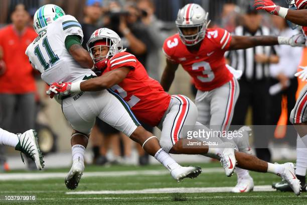 Sevyn Banks of the Ohio State Buckeyes drops Amare Jones of the Tulane Green Wave for a oneyard loss in the first quarter at Ohio Stadium on...
