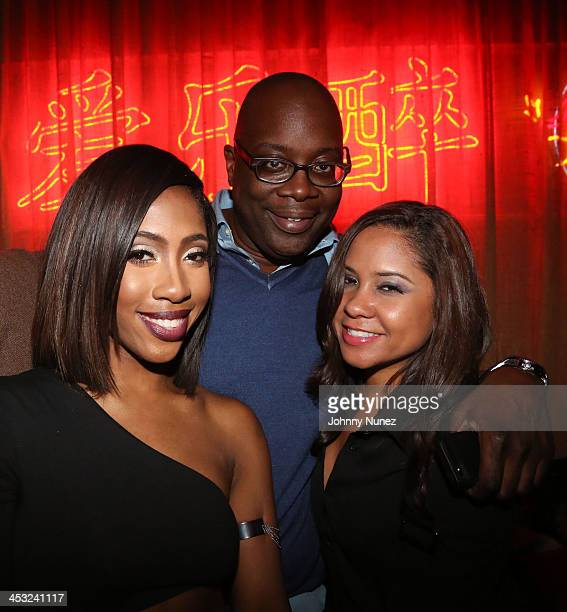 Sevyn Streeter Michael Kyser and Angela Yee attend the Sevyn Streeter Album Release Party at Mister H on December 2 2013 in New York City