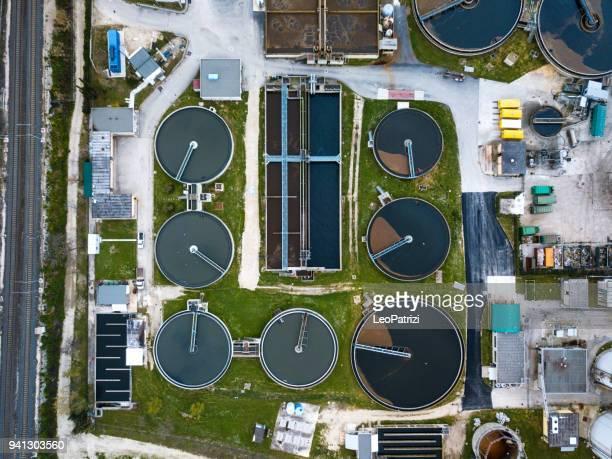 sewage treatment factory in italy - aerial view - estação de tratamento de esgotos imagens e fotografias de stock
