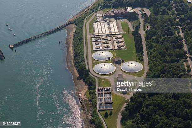 Sewage treatment plant at edge of bay
