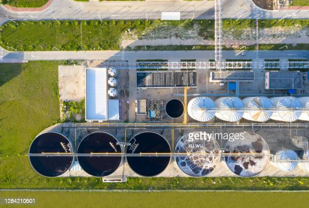 sewage treatment plant from the perspective of drone - storage tank stock pictures, royalty-free photos & images