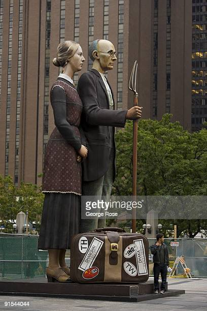 J Seward Johnson's large sculpture 'God Bless America' based on Grant Wood's 'American Gothic' painting is seen in this 2009 Chicago Illinois early...