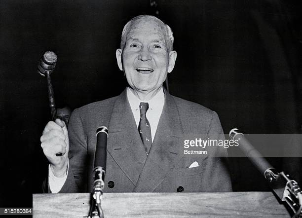 Sewell Avery, Montgomery Ward Chairman of the Board of Directors, pounds the gavel to get under way the proxy battle for control of the mail order...