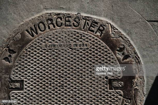 A sewer grate is adorned with the name Worcester in an economically stressed section of the city on March 20 2018 in Worcester Massachusetts...
